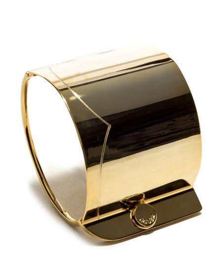 RIGID BRACELET COLOR GOLD-Gold tone rigid bracelet in metal with wave pattern on top plaque. Side closure.