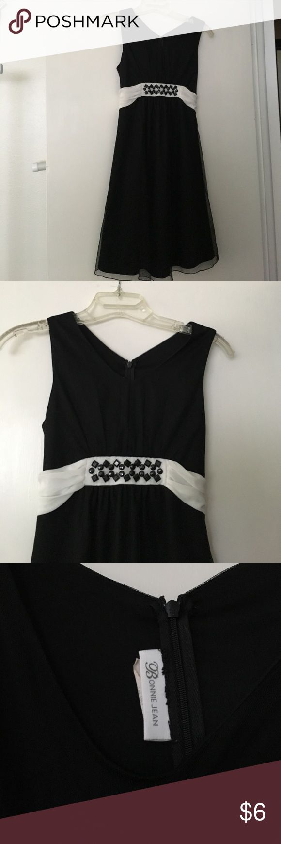 Girls size 14 brand Bonnie Jean Girls size 14 special occasion dress by Bonnie Jean. Black and white with bow that ties in back. Gems sewn on front. Bonnie Jean Dresses Midi