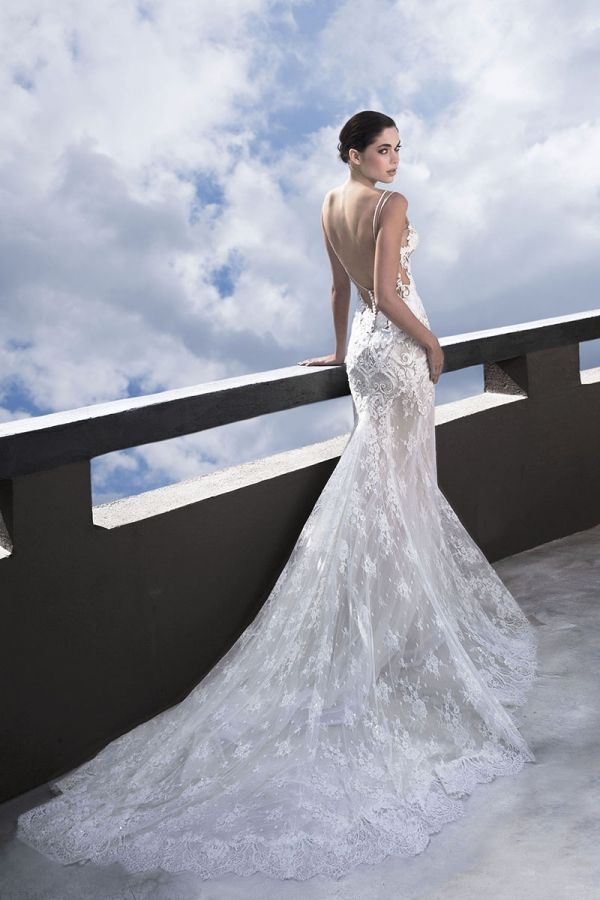 Off white mermaid made with a combination of French Chantilly lace and Applique Guipure lace and open back