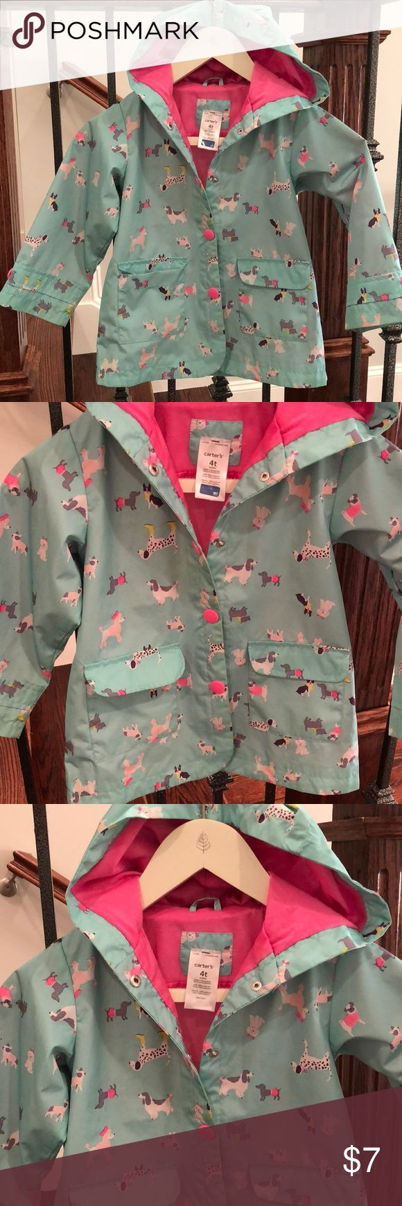 Girls puppy dog raincoat Cutest little raincoat!! Girls size 4T by Carters. Button front with pockets and hood. Coat is pre-loved and shows some signs of wear (light marks, see picture 6). No punctures or tears to fabric. Lots of wear left and ready for a new little puppy lover!! Questions welcome. Carter's Jackets & Coats Raincoats