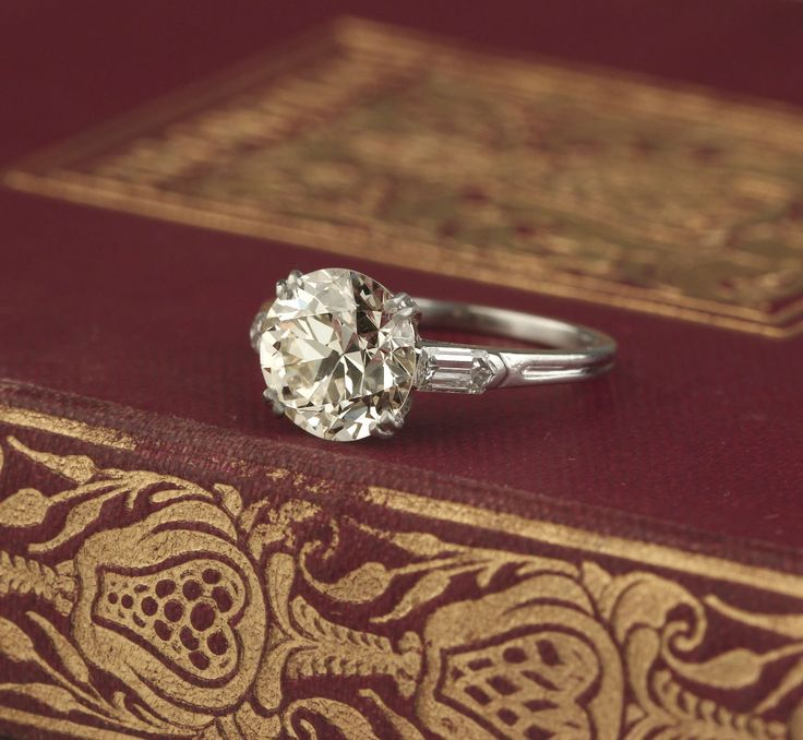 Circa 1930s Engagement Ring. Center old european cut diamond 2.85 carats. Unique bullet shaped side diamonds. Platinum