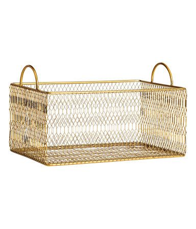 Gold-colored. Metal storage basket with handles at upper edges. Size 4 1/2 x 6 1/2 x 9 3/4 in.