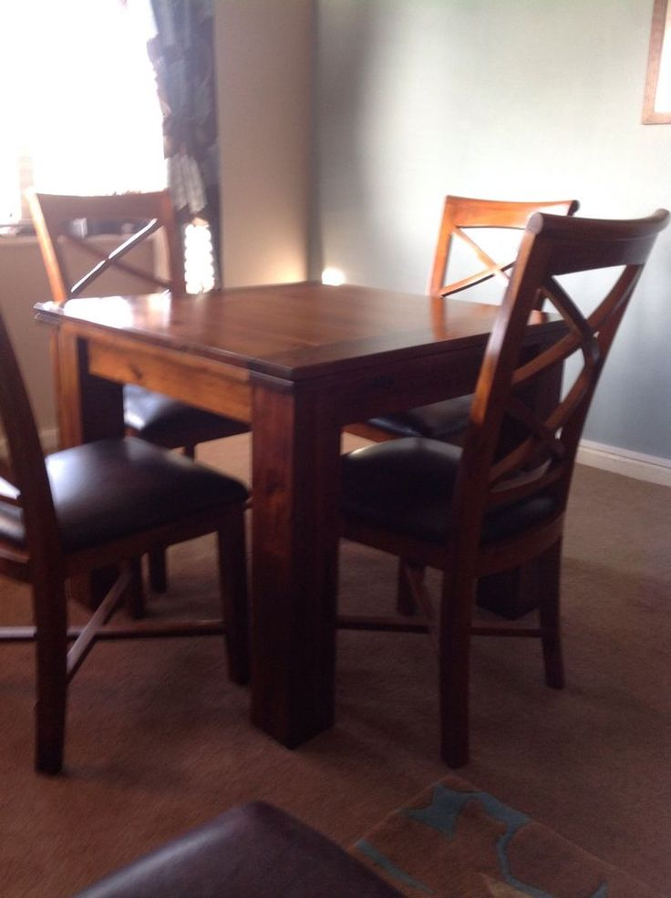 solid wood flip over table and 4 brown leather chairs