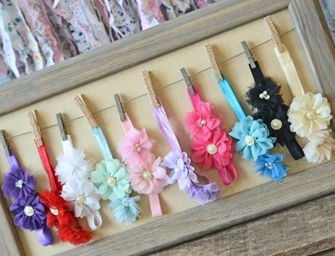 I like this headband holder idea, clothespins and twine in a picture frame..would be a cute functional wall decoration!
