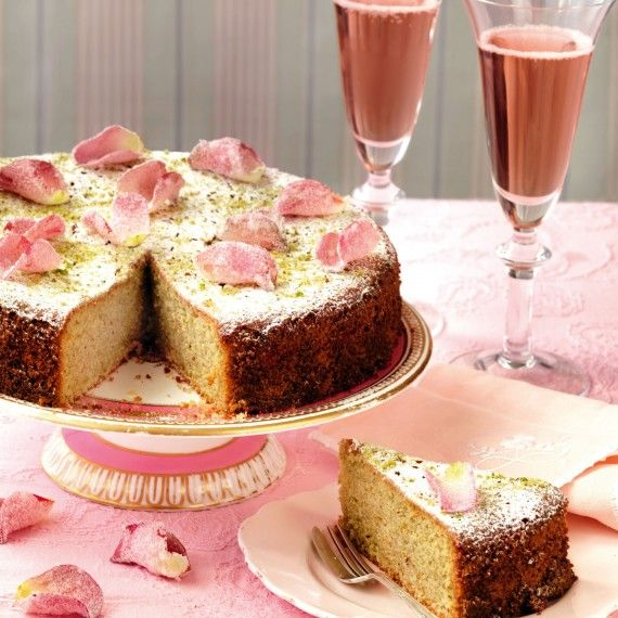 A beautiful petal-topped pistachio and rose water cake recipe - http://www.womanandhome.com/recipes/530659/pistachio-and-rose-water-cake#