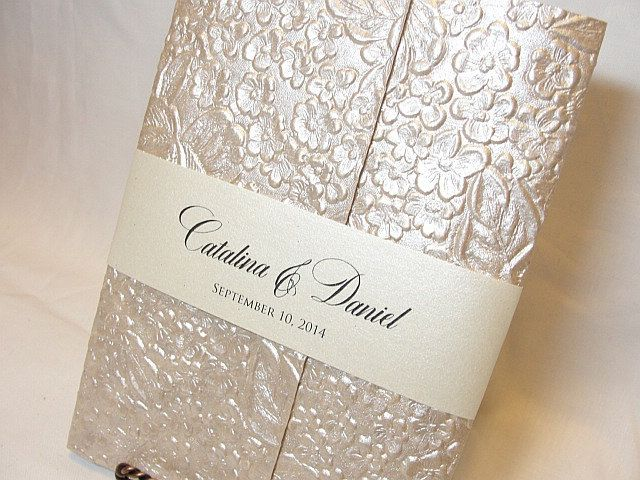 SARAHIE   2 Embossed Floral Hand Made Paper Wedding Invitations. $562.50,  Via Etsy.