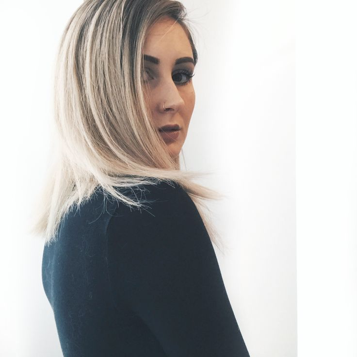 Beige blonde hair colour with mid length cut