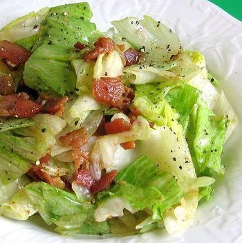 This old fashioned wilted lettuce salad is served with a tangy hot dressing. It's a very simple salad, a southern classic.