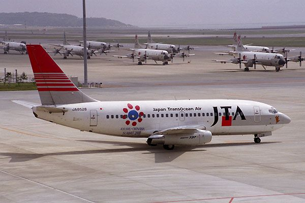 Japan TransOcean Air-JTA (JP) Historic fleet Boeing 737-205(A) JA 8528 aircraft, with the sticker '' Kyushu-Okinawa summit 2000'' on the airframe, skating at Japan Kitakyushu Airport.