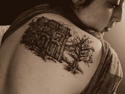 Haunted House tattoo on the back