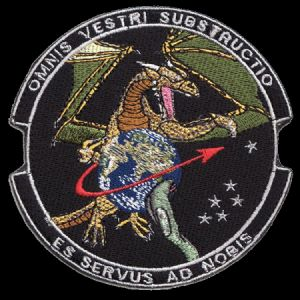 """US military patch featuring the reptile theme and a Latin motto.   Rough translation: """"With all your bases, you're a slave to us."""""""