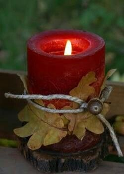 hot glue leaves around candle, tie with twine or raffia, accent with acorns