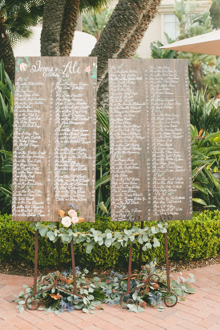 Seating Chart on weathered boards - See the wedding here: http://www.StyleMePretty.com/california-weddings/2014/05/14/classic-elegant-pelican-hill-resort-wedding/ Photography: One Love Photo - onelove-photo.com