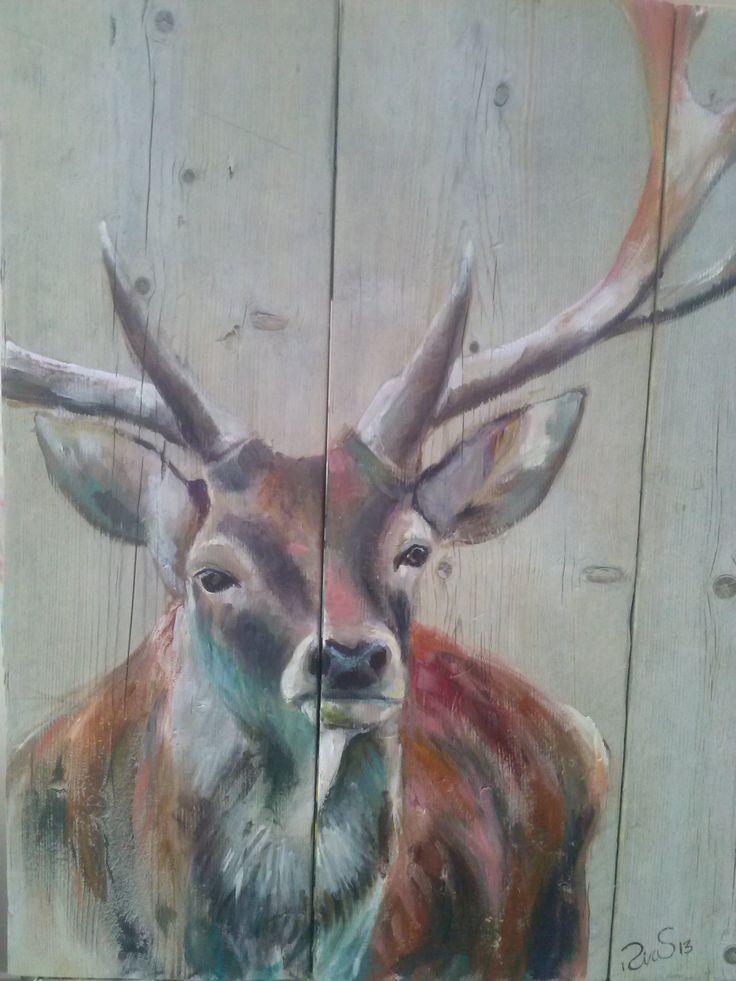 Hert geschilderd op steigerhout