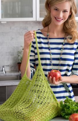 The Mesh Knit Market Bag is a great accessory for shopping in style. The lacy mesh sides make this bag a great choice for carrying produce. This knit bag pattern is an easy project, perfect for someone venturing into larger projects for the first time.
