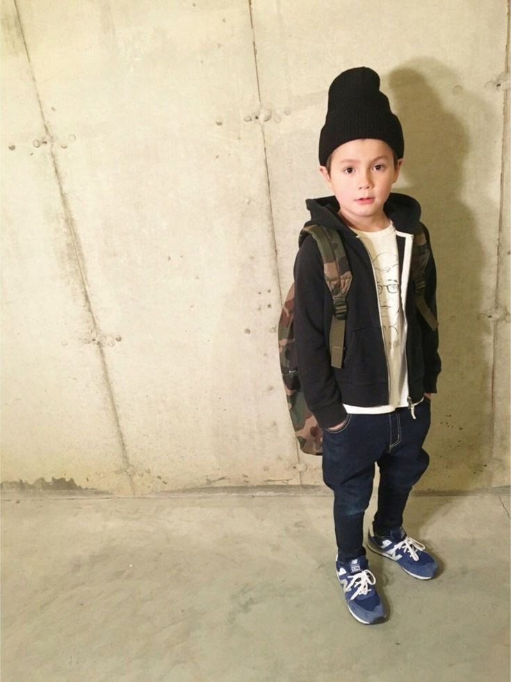 So grown up kiddo with a backpack beanie and sneakers