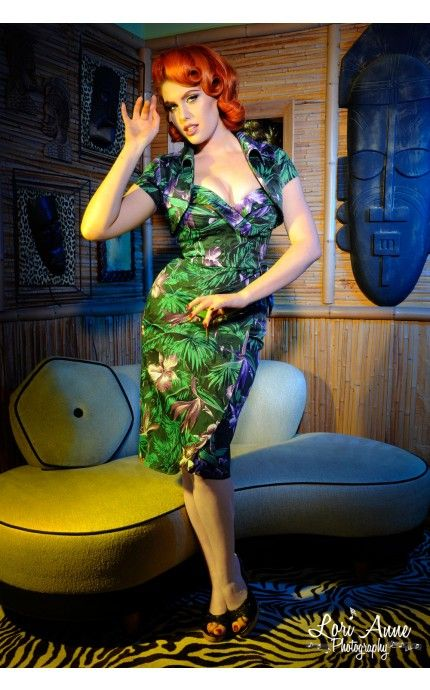 Much like the classic Hawaiian dresses from the 1950s, the Malibu Tiki Dress is made from a rich cotton sateen, has a fully built in bullet bust with padding, and a new side tie. The tulip skirt has been slightly lengthened and the straps are now our ever-popular adjustable straps (like the Vamp top). Includes the matching bolero - now double-lined for even more stability. - See more at: http://www.pinupgirlclothing.com/malibu-tiki-green.html#sthash.nYhh4y33.dpuf