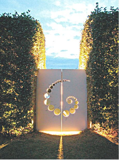 Love the Light effect on the back... - Comment by Mercurelli's Garden Design - {Crop Circle Garden Gate from pwlimited website}