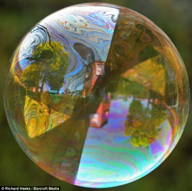 Super-slow-motion pictures show soap bubble bursting in stunning detail