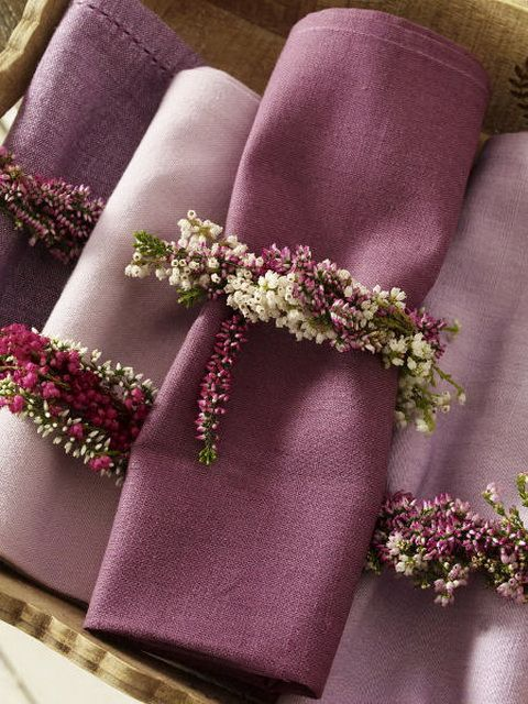 Linen napkins in Lavender shades wound with tiny floral embellishments.