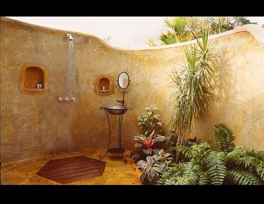 This outdoor shower feels as close to a indoor shower as possible while still being outside.  It's very roomy!