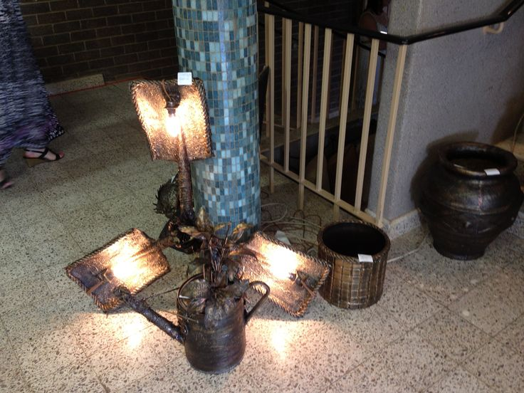A hanging light with 3 spades joined together. Great for a patio!