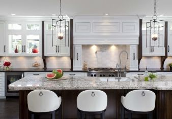 Kitchen cabinets and counters.  Dark island with speckled granite.  White wall cabinets with dark counter.