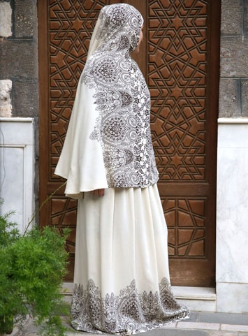 I like this very much. These loose skirts & long scarves are designed to wear over regular clothing for prayer time (salat). Usually they are sort of plain...I may purchase it to take & wear @ the Eid prayers this year.