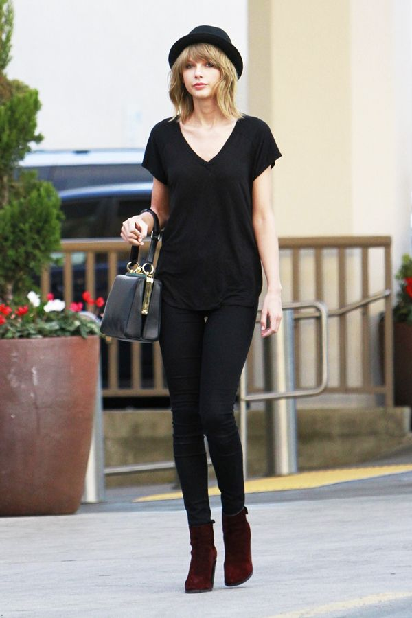 Taylor Swift ambles down a Los Angeles street wearing head-to-toe black, topped off with a porkpie hat, because bad hair days afflict even the history-making performers among us.: