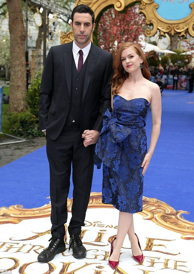 Perfect pair: Isla Fisher looked stunning on the red carpet with husband, Sacha Baron Cohen, for the Alice Through The Looking Glass European Premiere in London on Tuesday