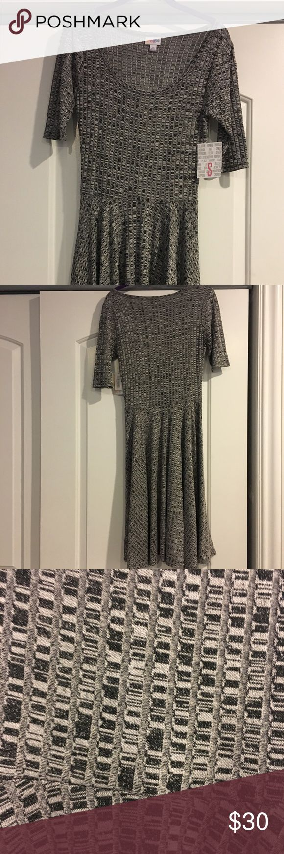 NWT LuLaRoe Nicole Dress NWT LuLaRoe Nicole dress, size small. Gray, silver and white, ribbed and stretchy.  Perfect for work or for a night out! LuLaRoe Dresses
