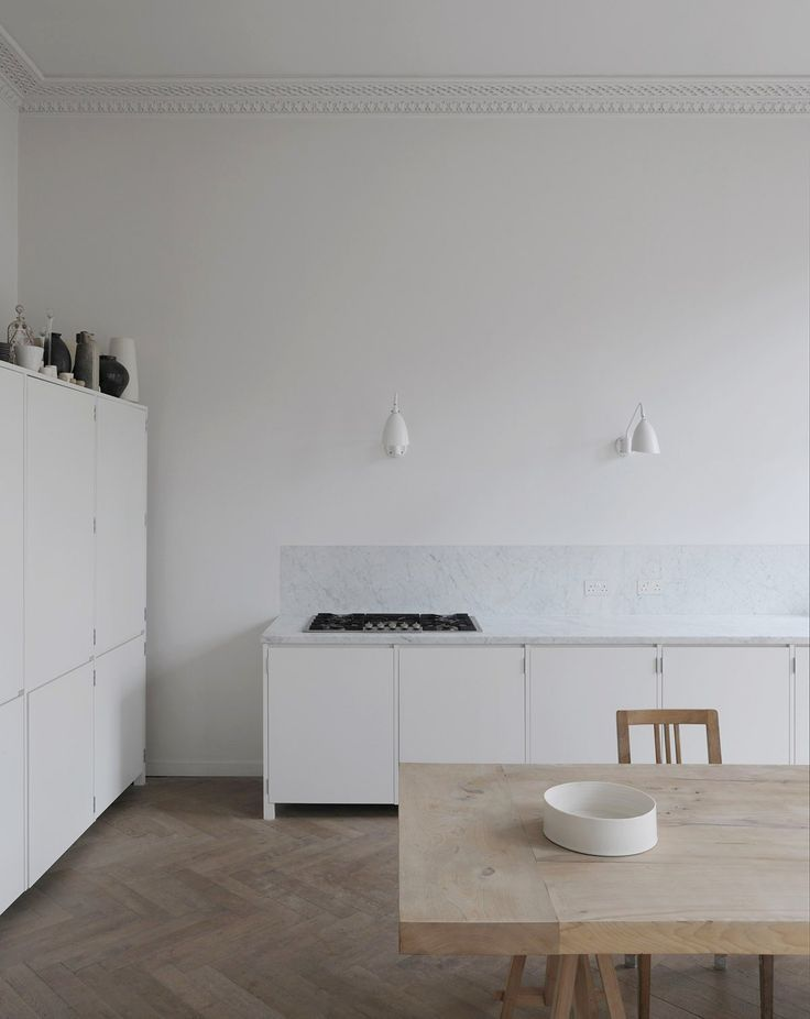 Minimal kitchen inspiration with marble and wood. Herringbone floor and marble worktop / sink unit. Marble and wood kitchen perfection.