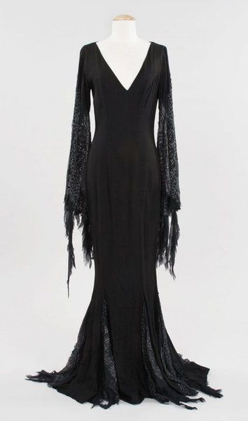 The original Morticia Addams costume. ::siiiiiiigh:: I would love to wear something like this, if only I could silence the Body Image Demons...