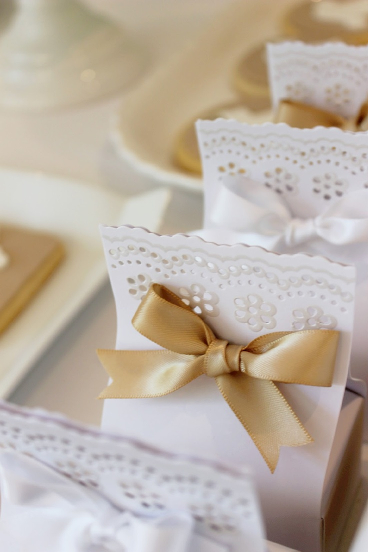 Pretty party favor idea: Use a craft store lace punch to finish the edges of paper that is wrapped around a gift.