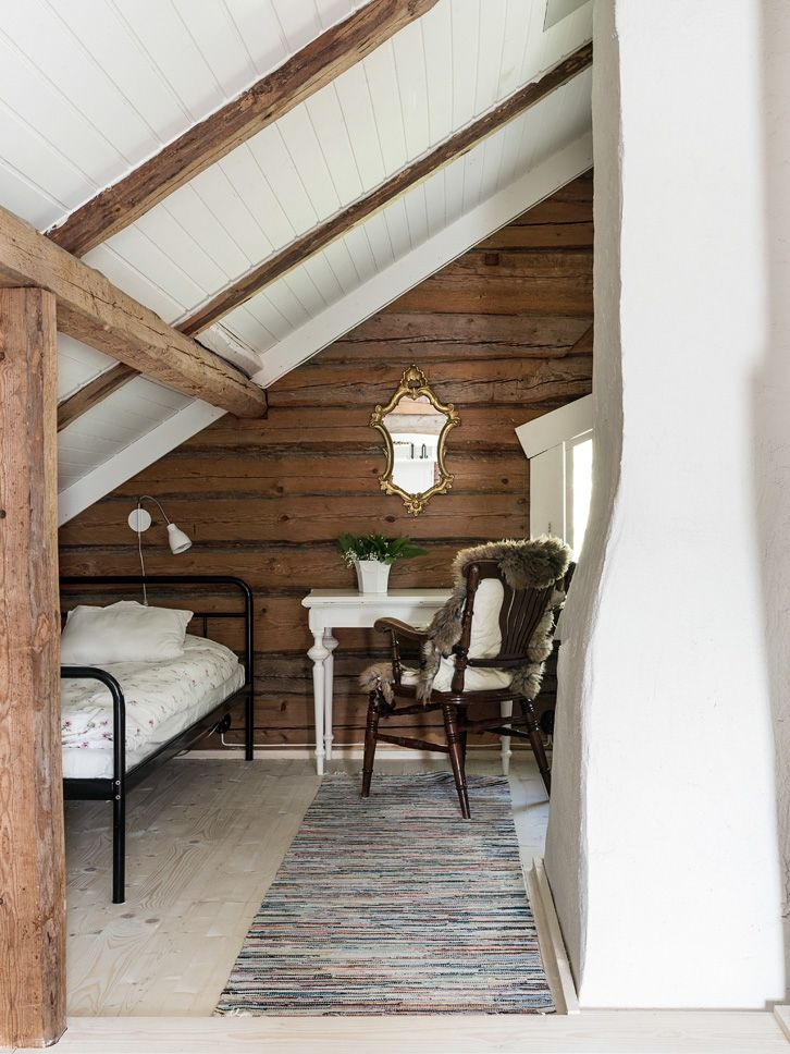 Finishing an attic space. Love the exposed beams and the shiplap walls. The white panels (tongue and groove?) on the ceiling and the light colored wood floor help keep the space from being too dark.