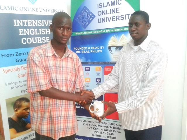Congratulations to brother Sambou Kinteh on winning an IOU mug and a key-chain for helping new students in getting enrolled at the University. May Allaah reward him abundantly!  www.iou.edu.gm