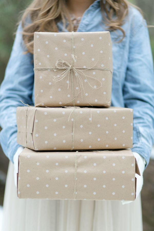 christmas wrapping brown paper packages to hold the mittens