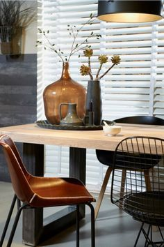 Mixing wood, metal, leather, glass and ceramics * rustic, but warm dining area. | via: decoratingyoursmallspace.com