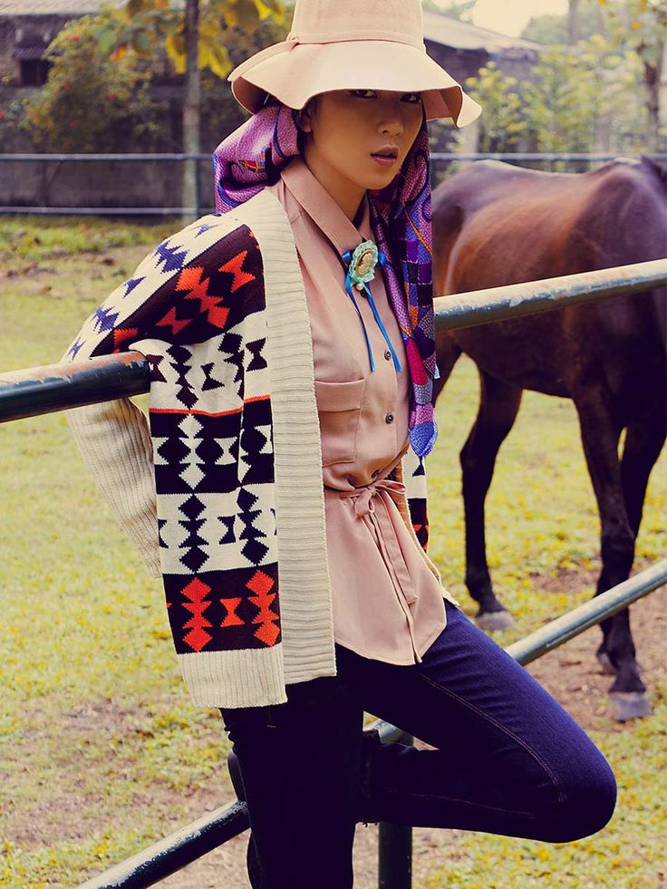 Crème wide-brimmed hat, The Style United<br/> Purple sateen headscarf, The Style United<br/> Mixed-colour tribal-pattern knitted cardigan, (X).S.M.L<br/> Vintage brooch and necktie ribbon, stylist's own<br/> Crème de la crème blouse, (X)S.M.L<br/> Indigo blue skinny jeans, Easton Jeans