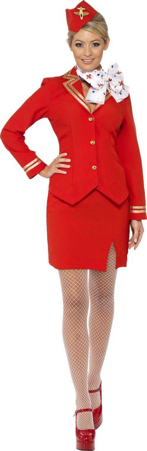 Fato de hospedeira vermelho mulher: Esse disfarce de hospedeira vermelho para mulher é composto de um casaco, uma saia, um chapéu e um cachecol (collants e sapatos não incluído). O casaco é vermelho...