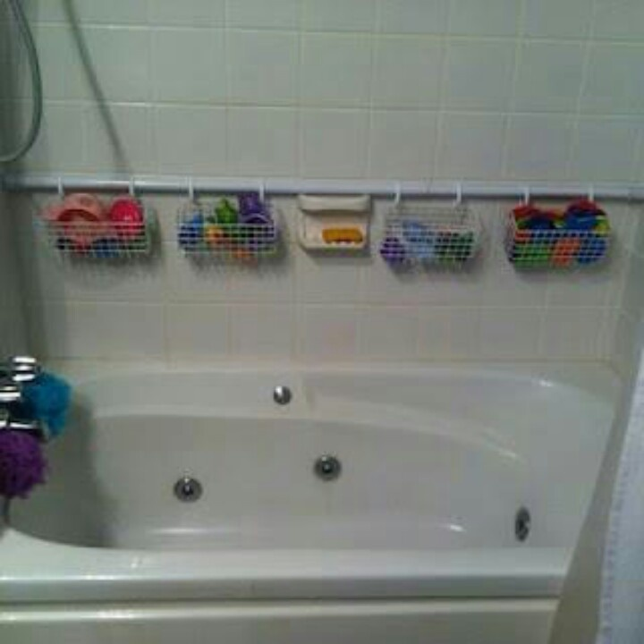 Bathtoy organization with limited space. Use a spring liaded shower rod at the back if the tub, add some hanging baskets and put in toys