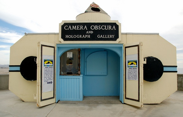 Camera Obscura: This tiny museum also known as the 'Giant Camera' is on the grounds of the historic Cliff House and features a working camera obscura, which reflects images of the beach front outside. It also houses a small collection of holograms.  The technology for the camera obscura is ancient, and was popularized starting in the Renaissance when artists used the technique to draw from life.