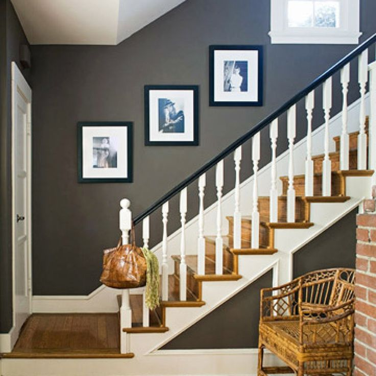 A rich cocoa makes the small entryway seem grand. Black semigloss paint on the railing and accents of crisp white create a bold contrast, one of the keys to livening up a neutral palette. Lisa's collection of movie star photos from the 1920s and '30s injects glamour. - FamilyCircle.com