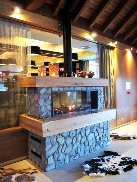Fireplace in the entrance lobby at Ana Sport Hotel in Poiana Brasov, Romania.