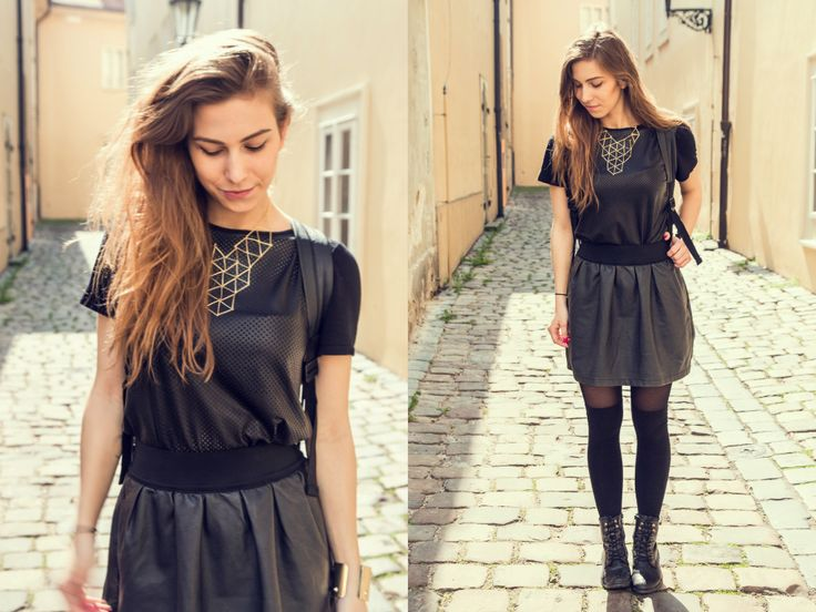 All leather outfit, wearing leather high-waisted skirt, big golden necklace and leather top.