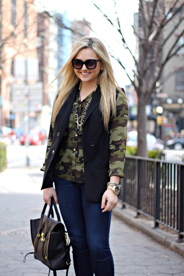 Camo blouse with vest and statement necklace.