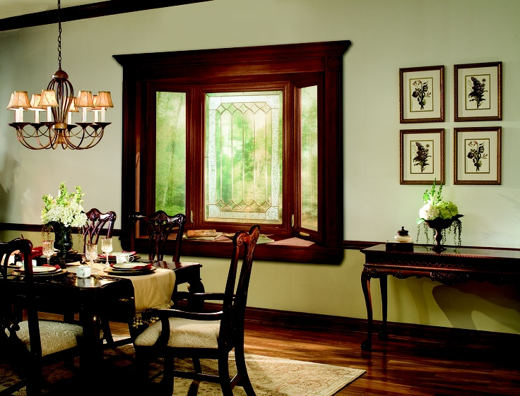Bay Window with optional woodgrain interior and decorative glass. Learn more at soft-lite.com
