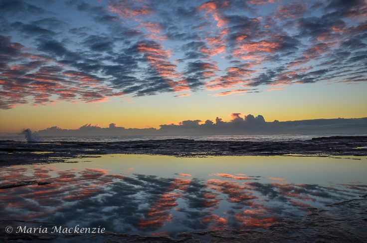 Sunrise at ILUKA BLUFF BEACH NSW. Having this mirrored reflection from the rockpool indicated how calm it was that morning. This was the 1st time I was able to capture the stripe formation in the cloud.