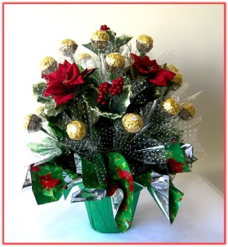 """""""RED POINSETTIA"""" Candy Bouquet : This gorgeous Candy Bouquet is made of 21pcs Ferrero Roche chocolates, combined with silk flowers and colourful cellophane, nested in a terracotta pot.    Prices start at AUD $ 34.95   Price as shown AUD $ 54.95    Code: CB 0333"""