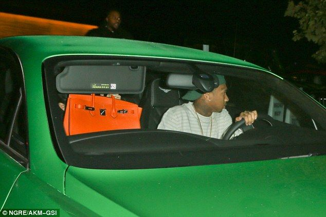 Low profile: The pair were seen making their way out of the popular sushi restaurant, Nobu...
